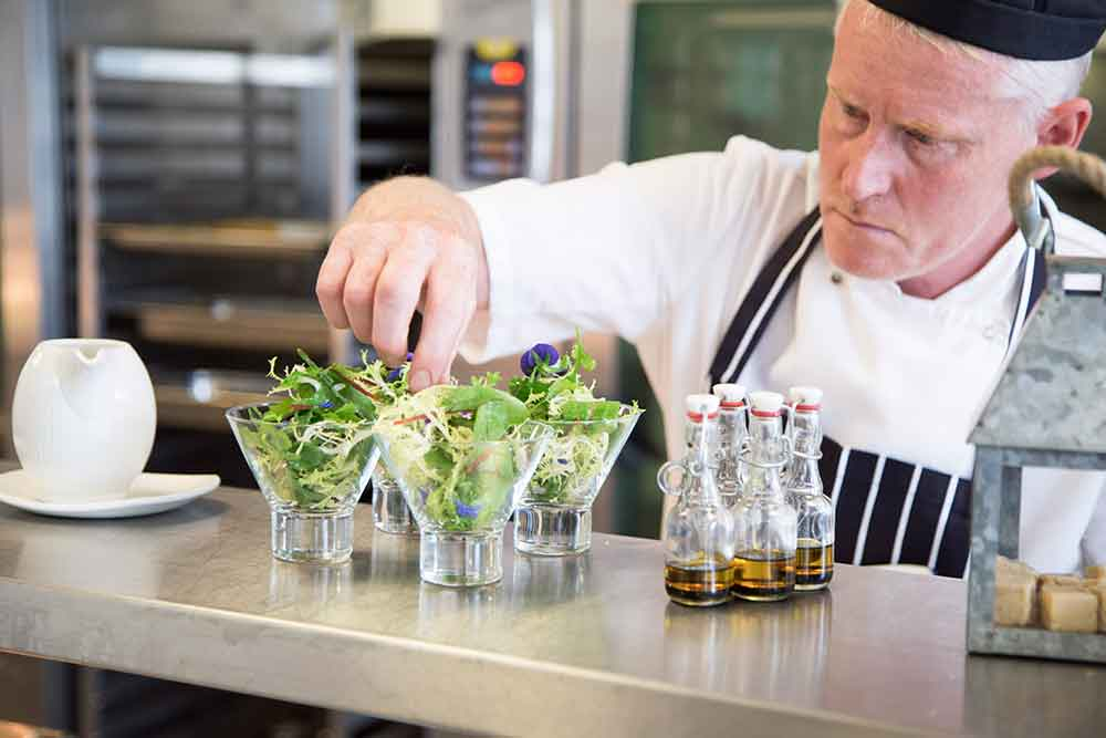 chef setting out salads