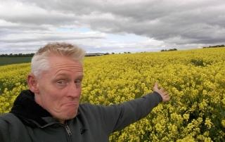 farmer with rape seed field